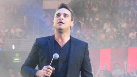 Robbie Williams vrea să renunţe la muzică şi să devină mecanic auto în Germania